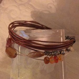 Bracelet with multiple rust leather strands